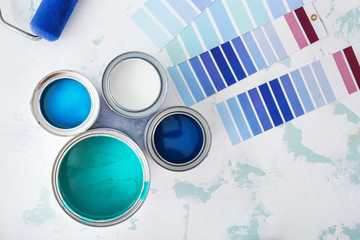 Obraz Cans of paint with palette samples on light background - fototapety do salonu