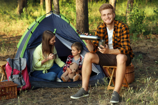 Happy family spending weekend in forest