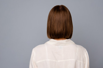 Close up back rear behind view photo beautiful amazing she her lady ignoring don't want speak tell talk say big offense bad awful terrible situation wear casual white shirt isolated grey background