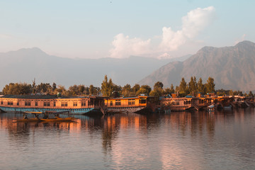 Famous Dal lake with shikaras(boats) in the water. Sunset time.