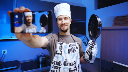 Cooking influencer shooting a video with smartphone