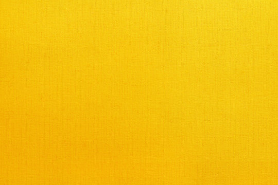 Yellow cotton fabric texture background, seamless pattern of natural textile.