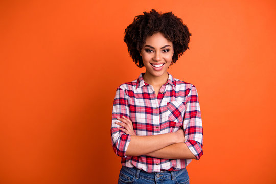 Portrait of her she nice attractive lovable lovely cheerful cheery content wavy-haired lady wearing checked shirt folded arms isolated on bright vivid shine orange background