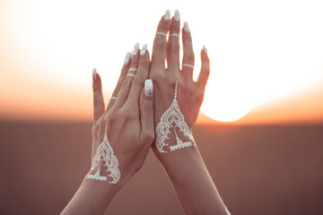Boho style white hand tattoo. Bohemian woman carefree at the sunset, outddoor photo. Wall mural