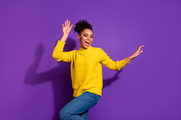 Fototapete - Portrait of cool teen teenager raise hands party maker scream shout wear yellow pullover denim jeans isolated over purple violate background
