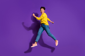 Full length body size profile side view portrait of her she nice attractive funny cheerful cheery ecstatic carefree wavy-haired girl having fun isolated over bright vivid shine violet background