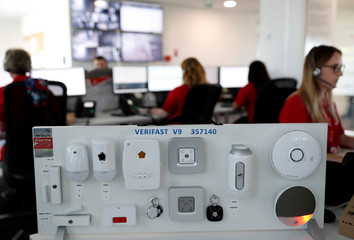 Detection elements are displayed as help desk staff work on their computers at the hub of Verisure, a provider of professionally monitored security solutions, in Angers