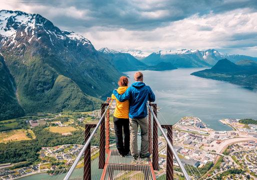 happy blue yellow couple tourists