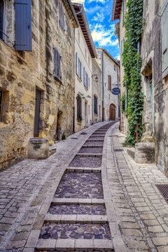 Old medieval stone buildings in the city of Uzes, in the Gard Department of France