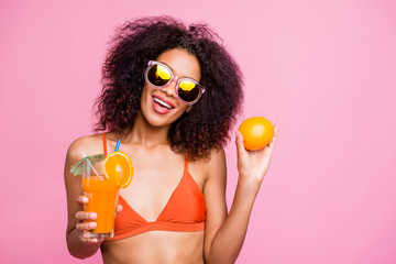 Close up photo beautiful funny she her dark skin model lady raise non sweet diet exotic beverage straw cafe bar citrus vitamin c fruit wear sun specs swimming orange suit isolated pink background