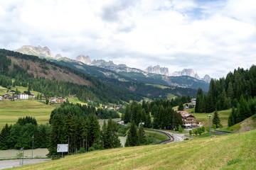 Soraga, little village in Val di Fassa, Trentino, italian Dolomites, Italy. View of Catinaccio range