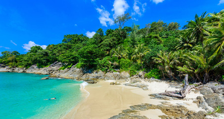 Fototapeta Freedom beach, Phuket, Thailand - Tropical island with white paradise sand beach and turquoise clear water and granite stones. obraz