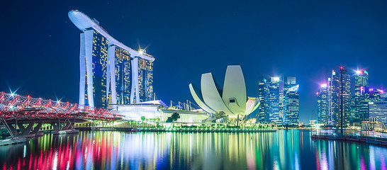 Poster de jardin Singapoure Panorama of Singapore cityscape. beautiful business modern building skyscraper around Marina bay at night. landmark and popular for tourist attractions : Singapore, 9 May 2019