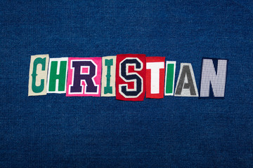 CHRISTIAN collage of word text, multi colored fabric on blue denim, Christianity religion diversity concept, horizontal aspect
