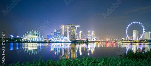 Fototapete Panorama of Singapore cityscape. beautiful business modern building skyscraper around Marina bay at night. landmark and popular for tourist attractions : Singapore, 9 May 2019