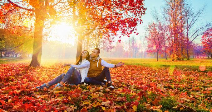 Happy Couple Enjoying The Fall Season. Autumn Landscape. Fall Scene