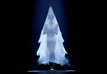 A model presents a wedding dress creations by designer Jean Paul Gaultier as part of his Haute Couture Fall/Winter 2019/20 collection show in Paris