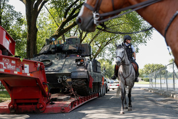 A Mounted U.S. Park Police Ranger rides past a Bradley Armored Fighting Vehicle parked across from the Lincoln Memorial in Washington