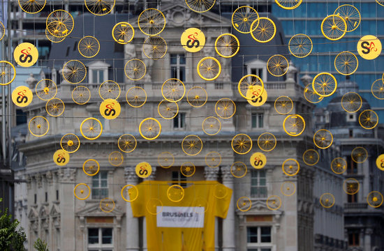 The logo of the Grand Depart of the 2019 Tour de France cycling race is pictured near yellow wheels in central Brussels