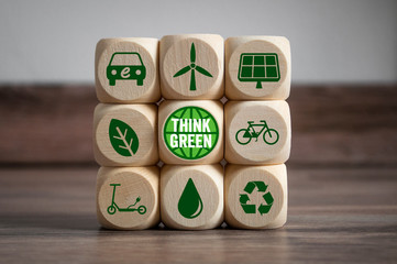 Cubes and dice with think green and save our planet with green electricity Wall mural