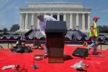 Workers place presidential podium during July Fourth preparations at the Lincoln Memorial in Washington