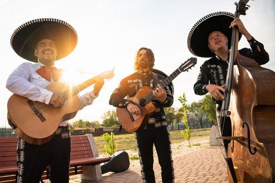 Mexican musicians mariachi band street concert