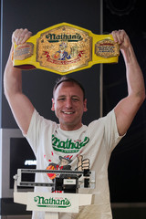 Current world record holder Joey Chestnut poses during the official weigh-in ceremony for the Nathan's Famous Fourth of July International Hot Dog Eating Contest at the Empire State Building in New York
