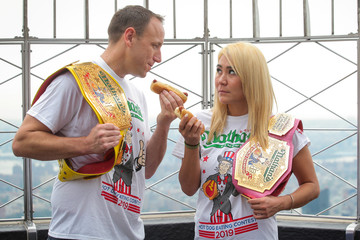 Current world record holder Joey Chestnut stares down with current women's champion Miki Sudo during the official weigh-in ceremony for the Nathan's Famous Fourth of July International Hot Dog Eating Contest at the Empire State Building in New York