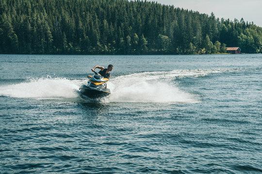 Jetski playing during summer on a lake