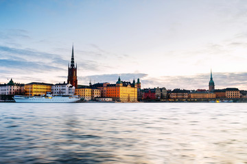 Wall Mural - View of Gamla Stan in Stockholm, Sweden with landmarks like Riddarholm Church during the sunrise