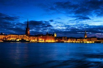 Wall Mural - View of Gamla Stan in Stockholm, Sweden with landmarks like Riddarholm Church during the night