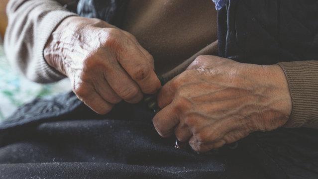 old wrinkled hands of elderly woman. Coronavirus risk group. COVID virus infection.
