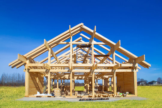 Frame house under construction. Construction site on a sunny day. House from laminated veneer timber. Remodeling of the cottage. The house wooden base. Houses to order. Production of wooden houses.