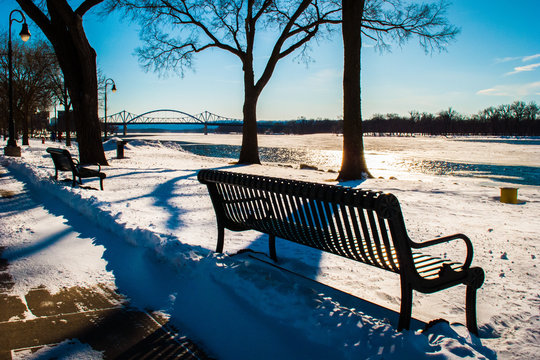 Park Bench and Bridge on Ice-Covered Mississippi 1