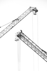 Black and white of Workers on a large construction crane on white background