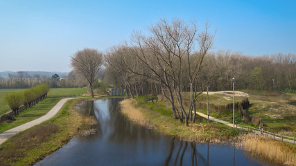 Panoramic view of river and woods, trees reflecting in the water, nature reserve Het Zwin,  Knokke-Heist, North Sea Coast at the border of Belgium and The Netherlands