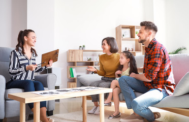 Family visiting psychologist in office