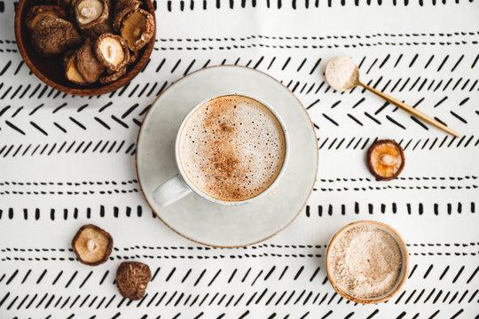 Top view of mushroom latte with shiitake powder and vegetarian blend milk. Healthy useful vegan drink, flat lay.