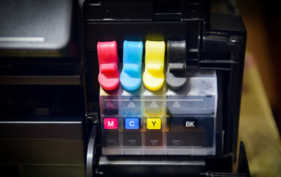printer ink tank for refill at office - Close up printer cartridge inkjet of color black CMYK