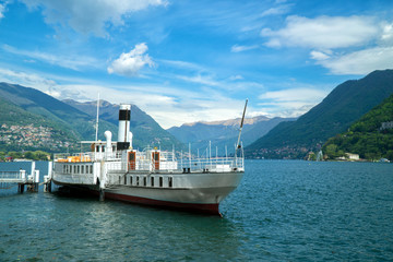 Beautiful white vintage ferry on Lake Como.