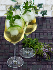 Hugo cocktail made with elderflower syrup, prosecco and a splash of sparkling water, decorated with mint sprigs