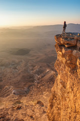 Watching sunrise in the Negev desert. Makhtesh Ramon Crater in Israel