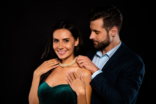 Close up side profile photo two beautiful people she her classy chic he him his macho giving receive take on neck bijouterie jewel wear plaid blue costume jacket green dress isolated black background