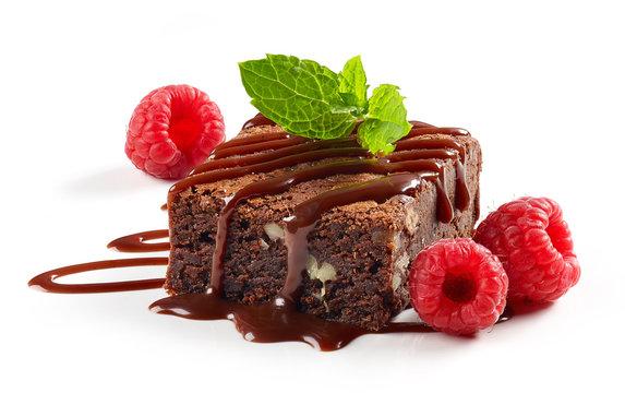 piece of chocolate cake brownie with raspberries