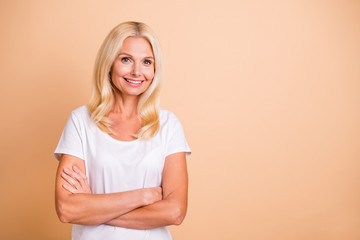 Photo of middle age lady pretty smiling neat appearance boss manager wear white casual t-shirt isolated pastel beige background