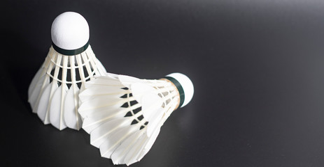 white badminton shuttlecocks lay on white table background