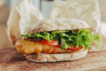 fried fish Sandwich with lettuce, tomato with tartar sauce. author's recipe street food
