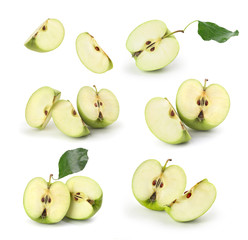 set of sliced green apples on a white background
