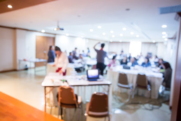 blurry image. speaker or lecturer with laptop and projector for presenting to business team brainstorming on meeting workshop.