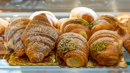 Italian croissants stuffed with pistachio and white cream.